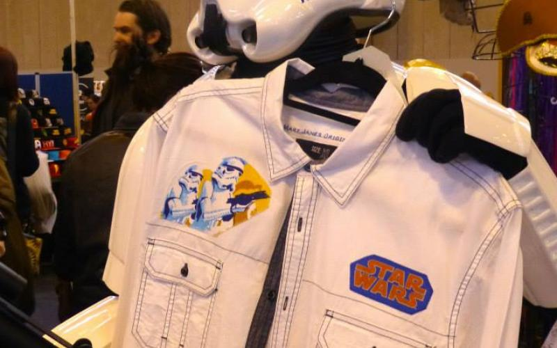A man dressed in a Strom Trooper outfit holding a white jacket.