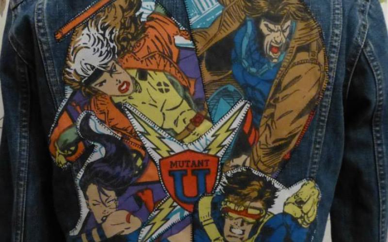 A dark-blue denim jacket with X-Men themed fabric.