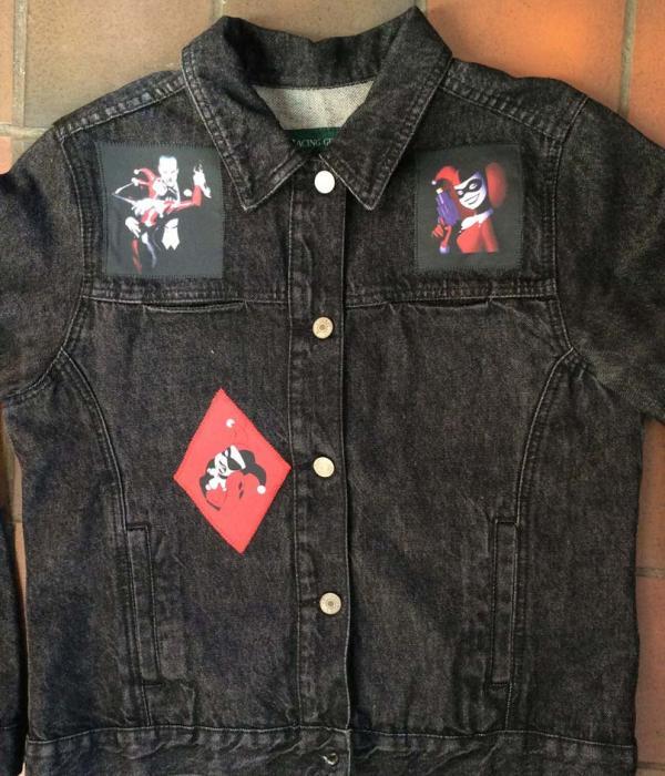 A black denim jacket with Harley Quinn themed fabric