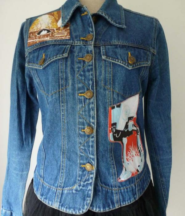 A denim jacket with Star Wars Return of the Jedi themed fabric