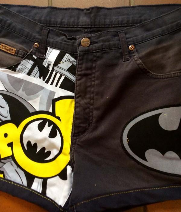 A pair of black denim shorts with Batman themed fabric