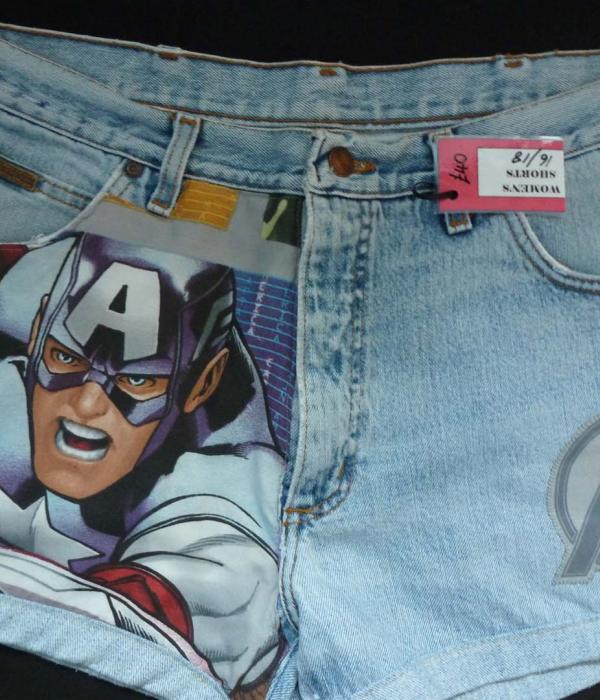 A pair of pale denim shorts with Captain America themed fabric