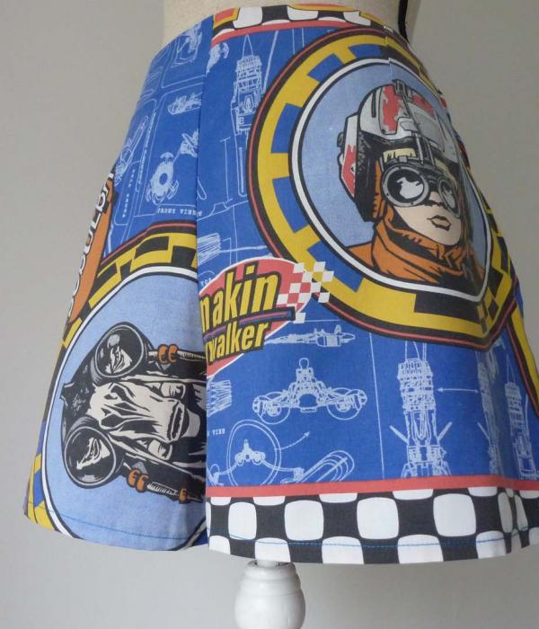 A pair of mid blue formal shorts with Star Wars The Phantom Menace themed fabric