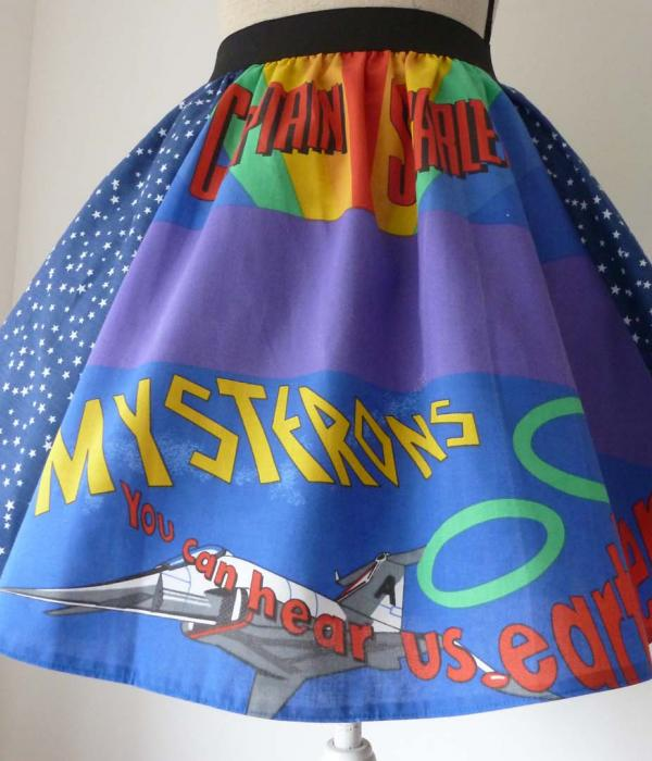 A Captain Scarlet themed skirt displayed on a mannequin that's multi-coloured