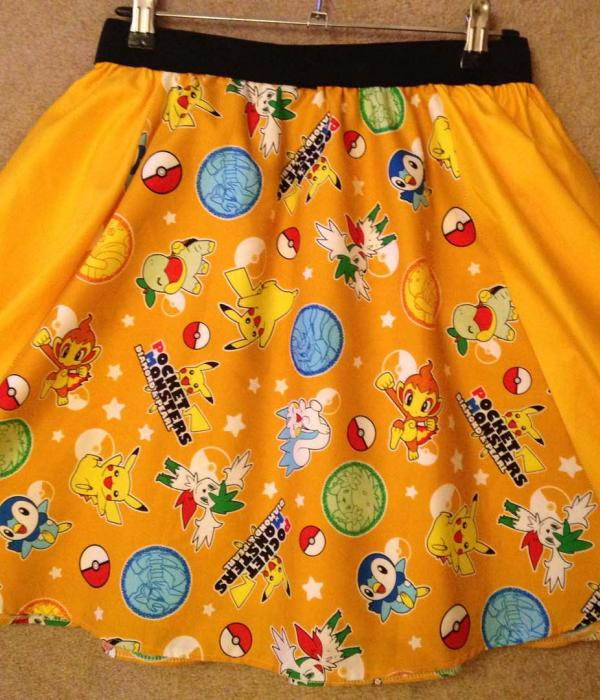 A skirt made from Pokémon themed fabric displayed on a mannequin