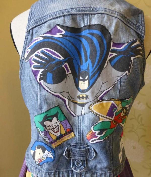 A mid blue denim waistcoat with Batman themed fabric