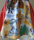 A skirt made from Star Wars Return of the Jedi themed fabric displayed on a mannequin